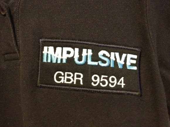 Badges stitched onto t-shirts