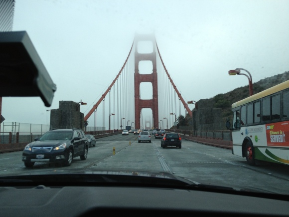 The Golden Gate bridge appearing through the mist