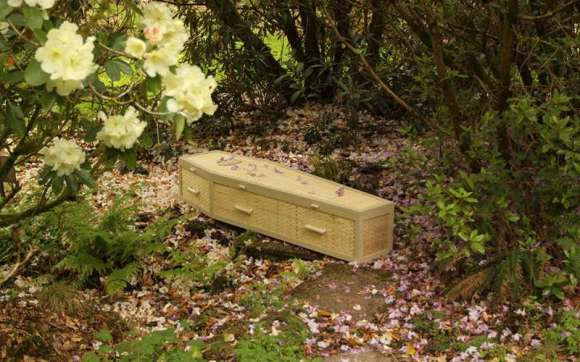 Bamboo Traditional Coffin Surrounded by Flowers